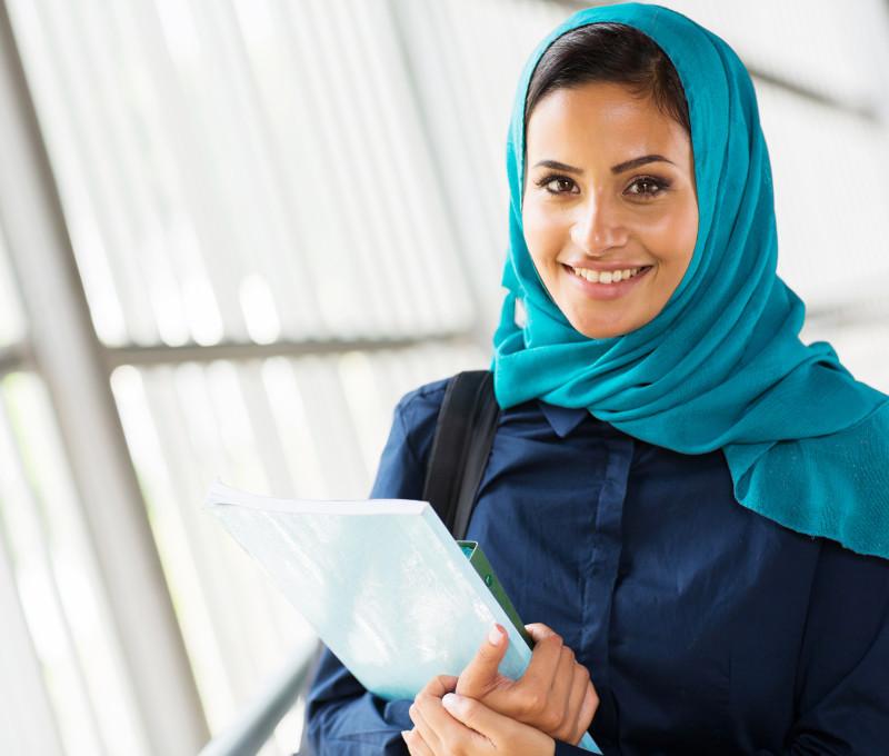happy female middle eastern university student